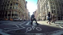 POV driving shot of Manhattan, NY with pedestrians crossing the street Stock Footage