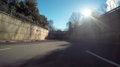 Point of view time-lapse driving shot entering the 9th st. expressway tunnel in  Stock Footage