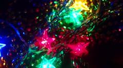 Preparing Xmas Decorations. Illumination garland decoration blinking bokeh - stock footage