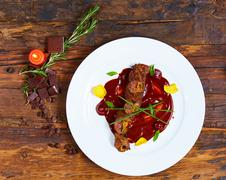 Roasted meat with vegetables and chocolate sauce Stock Photos