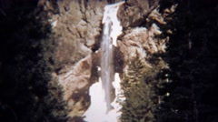 1971: Winter ice waterfall thawing showing frozen sections. Stock Footage