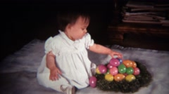 1971: Baby girl sulking with plastic Easter egg nest. Stock Footage