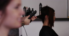 Close-up shot of a woman having her hair straightened. Shot on RED Epic. Stock Footage