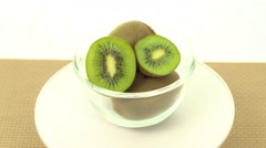 Fresh, ripe, green kiwis in rotating bowl - stock footage