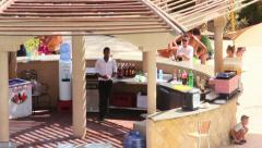 Barmen pours drink, serve people on vacation, Egyptian bartenders near beach Stock Footage