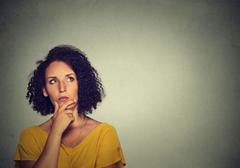 Woman thinking dreaming has many ideas looking up Stock Photos
