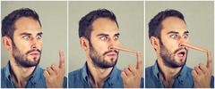 Man with long nose. Liar concept. Human face expressions, emotions, feelings. - stock photo