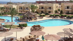 people spend time near a swimming pool in the hotel near bar - stock footage