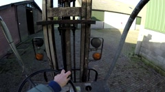 First person view driving forklift truck frok truck outside sunny day 4k Stock Footage