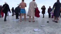 ORTHODOX HOLIDAY OF EPIPHANY. ICE-HOLE ON SMOLINO LAKE . CHELYABINSK Stock Footage