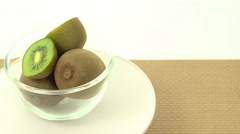 Fresh, ripe, green kiwis in rotating bowl Stock Footage