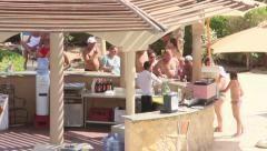 Bartenders serve people on vacation, pour drinks, Egyptian bartenders near beach Stock Footage