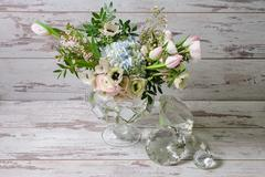Ranunculus and the anemones in vase of glass. - stock photo