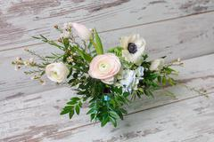 Stock Photo of Ranunculus and the anemones in vase.