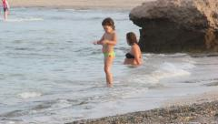 child walking on the beach near the mother. Red sea - stock footage
