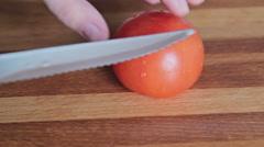 Woman's hands cutting mushroom tomato - stock footage