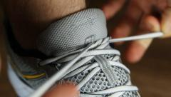 Man tying sports shoes in gym Stock Footage