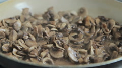 Grinded mushrooms roasting in pan Stock Footage