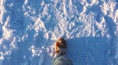 Feet of  man go on snow  winter, Slow motion Stock Footage