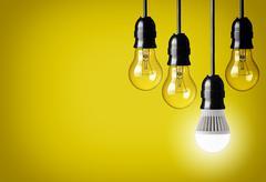 Idea concept on yellow background. Stock Photos