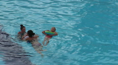 Mother and two daughters swimming in the pool, playing Stock Footage