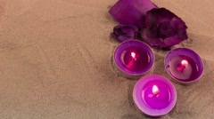 Candles and dry flower on the sand - stock footage