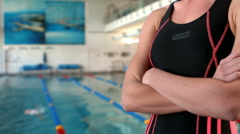 Smiling woman swimmer with arms crossed Stock Footage