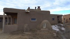 Zoom Out Shot of Traditional Indian House in Taos Pueblo, New Mexico Stock Footage