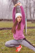 Fit Woman, doing stretching exercise,  healthy lifestyle concept, outdoor act - stock photo