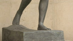 Vertical panorama shot of beautiful female sculpture exhibited outside building Stock Footage
