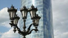 Beautiful antique street lamp near modern glass skyscraper, urban design Stock Footage