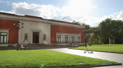 Old entrance of Bilbao Fine Arts Museum, people having rest in nice city park Stock Footage