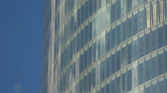 Bright blue sky reflection in window glasses of modern multi-storeyed building Stock Footage