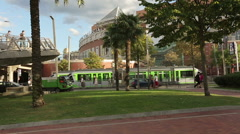 European city life, trams carry passengers, municipal services clean streets Stock Footage