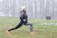 Stock Photo of Fitness Sporty Young Woman, outdoor exercising activity , winter season.