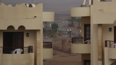 Egyptian road in the desert between the two buildings is rain Stock Footage