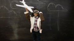 4K Little boy pilot in front of blackboard with drawings of clouds Stock Footage