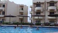 people spend time in the swimming pool at the hotel - stock footage