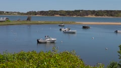 Man enjoying his boat on Cape Cod Harbor during a sunny summer day - stock footage