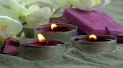 Candles & soaps and orchid flower on the sand - stock footage