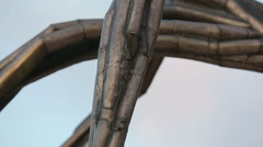 Horizontal panorama of modern bronze sculpture, detailed view of metal parts Stock Footage