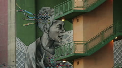 Horizontal panorama of huge street art, graffiti under La Salve Bridge in Bilbao Stock Footage