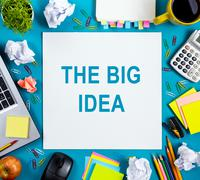 The big idea. Text words advice on office table desk with supplies, white blank Stock Photos