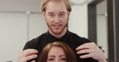 Young woman smiling while having a consultation with her hair stylist - stock footage