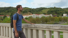 Young male tourist enjoying picturesque view and warm weather in Bilbao, Spain Stock Footage