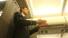 Steward in passenger aircraft shows the emergency exits Stock Footage