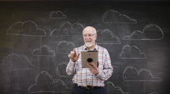 4K Portrait of thinking man standing in front of blackboard with clouds Stock Footage