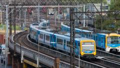 4k timelapse video of trains departing and arriving at a railway station - stock footage