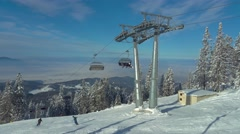 Chairlift in Poiana Brasov resort Stock Footage