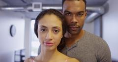 Close up of Black and Hispanic couple looking at camera standing in apartment Kuvituskuvat